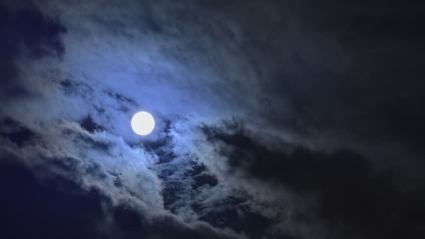 Full moon in Moonlight night behind clouds time lapse - HD stock footage clip