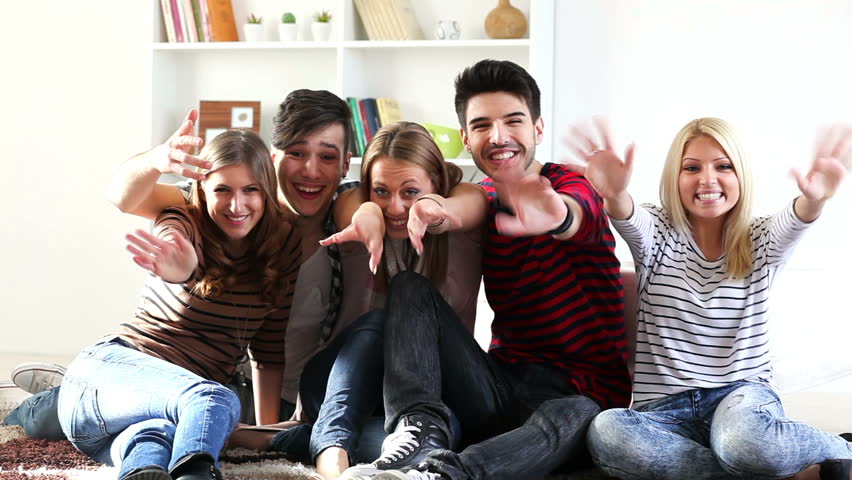Group of young people say hello and laughing.