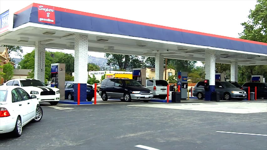 WHITTIER, CA - April 7, 2013: Time lapse shot of a busy, gas station with cars coming and going and people buying gas circa 2013 in Whittier. California gas prices are often in the news cycle.