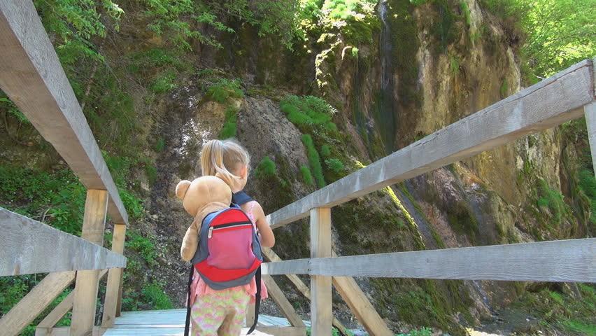 Child Walking on a Bridge over a Mountain River, Tourist in a Trip, Children