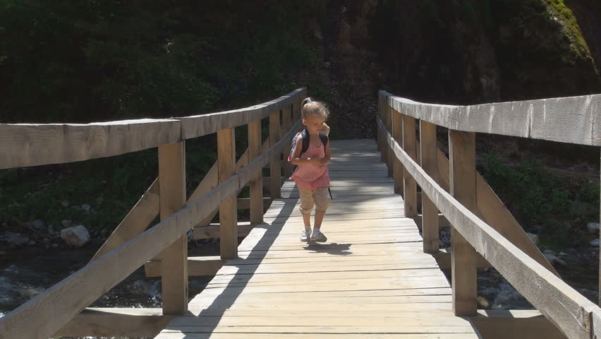 Child Running on a Bridge over a Mountain River, Tourist in a Trip, Children