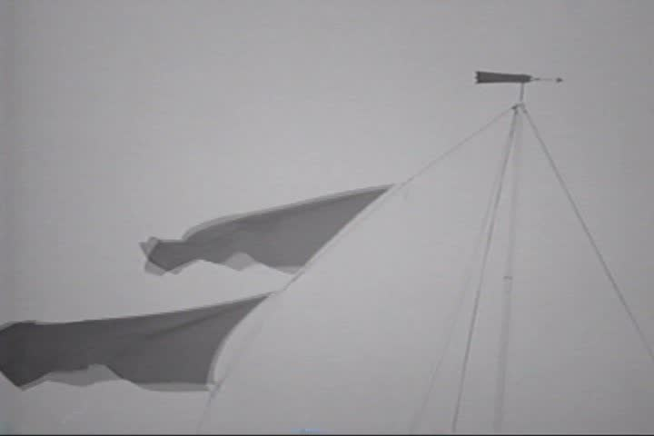 1940s - A young boy sneaks onboard his father's fishing vessel which then capsizes in a storm off Cape Cod. All hands are subsequently rescued by the fast and efficient work of the US Coast Guard. - SD stock footage clip