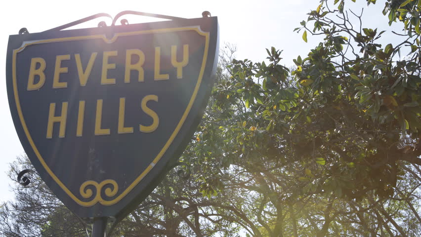 LOS ANGELES, USA - APRIL 15, 2013 The Famous Beverly Hills Sign, Trees, Street Sign, Los Angeles, California