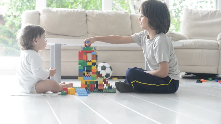 Little cute boy playing at home with toy cubes - HD stock video clip
