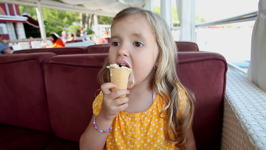 Pretty little girl eating ice cream
