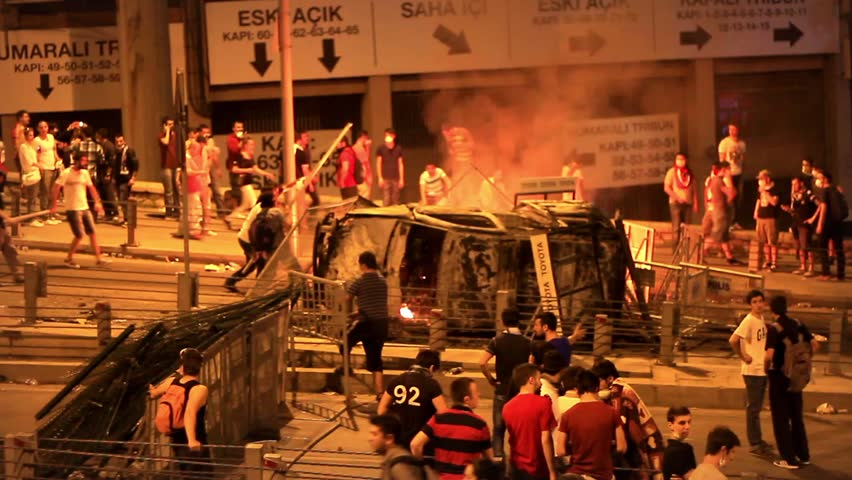 ISTANBUL - JUN 1: Violence sparked by plans to build on the Gezi Park have broadened into nationwide anti government unrest on June 1, 2013 in Istanbul, Turkey. Abandoned police car on fire