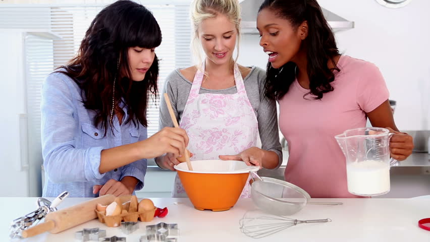 Three friends home baking together in the kitchen - HD stock video clip