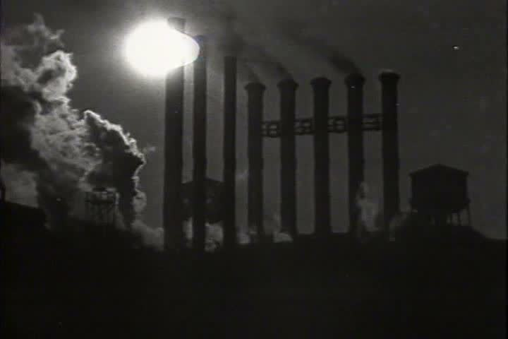 1920s - Industrial pollution and factories in the 1920s. - SD stock video clip
