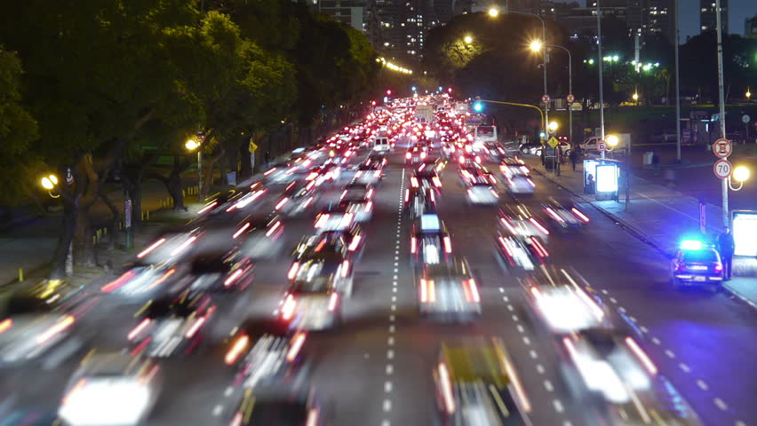 Traffic in the city. Avenue Time-Lapse, Night. Moon going down. Heavy traffic / jam / flowing with blurred motion. Dusk. Dolly out / zoom. | Shutterstock HD Video #4078870