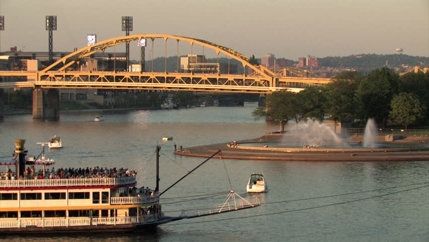 The Gateway Clipper riverboat passes in front of The Point in Pittsburgh, Pennsylvania. - HD stock footage clip