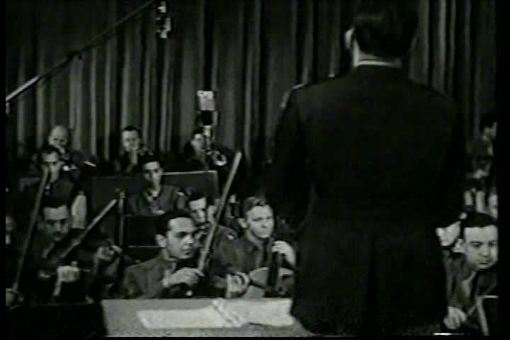 1940s - A filmed radio show for the army features Bob Hope entertaining. - SD stock footage clip