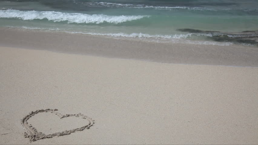 Heart on the sand, washed out by the waves - HD stock footage clip