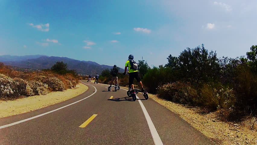 IRWINDALE/USA, CA: June 4, 2013- Wide angle shot of Trikke and bicycle riders on the San Gabriel River bike path circa 2013 in Irwindale. Shot demonstrates creative ways people find to fight obesity.  - HD stock footage clip