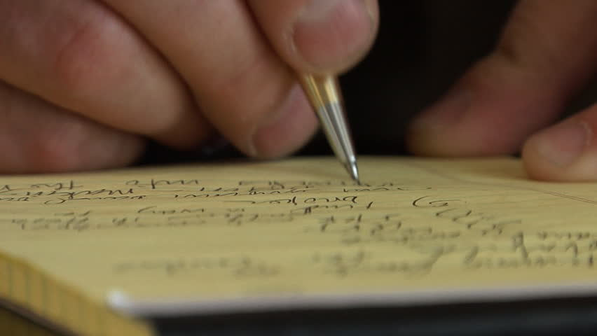 A businessman takes notes for the day's meetings. - HD stock footage clip