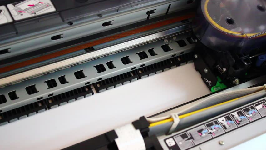 Wide format digital printer, plotter in Action. Printing test chart with color