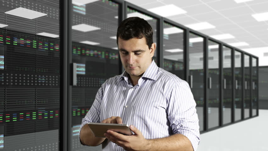 Young Man Tablet PC CPU Server Unit Room - HD stock video clip