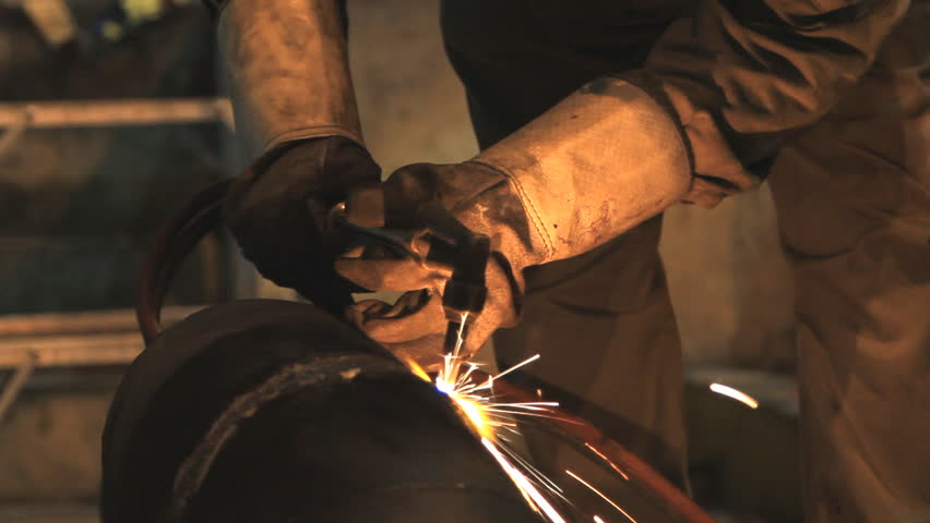 Industrial worker cutting steel by using metal torch. - HD stock video clip