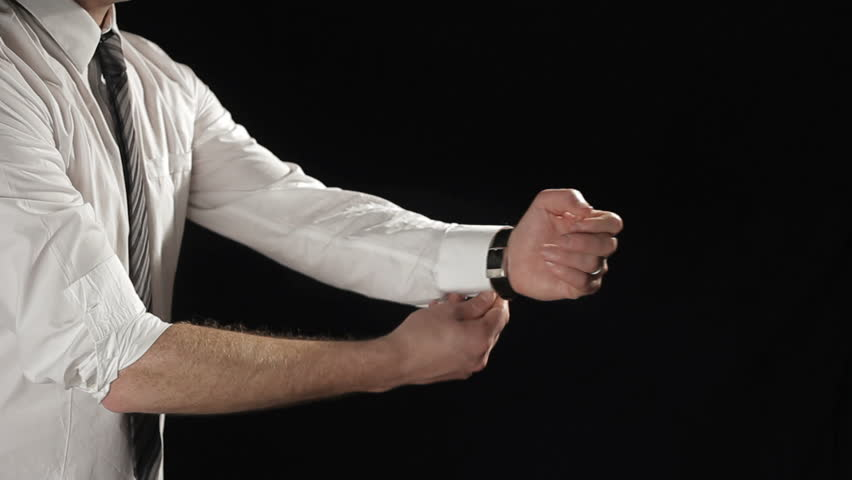 Businessman rolling up sleeves and boxing on black background. Find similar clips in our portfolio.