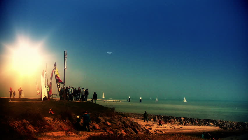 Kiting contest on the beach at sunset, zoom out