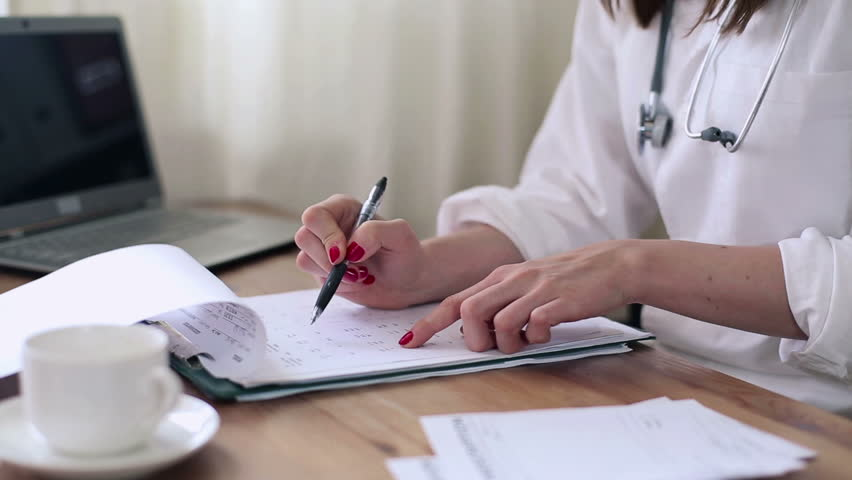 Female doctor working with documents in the office  - HD stock video clip
