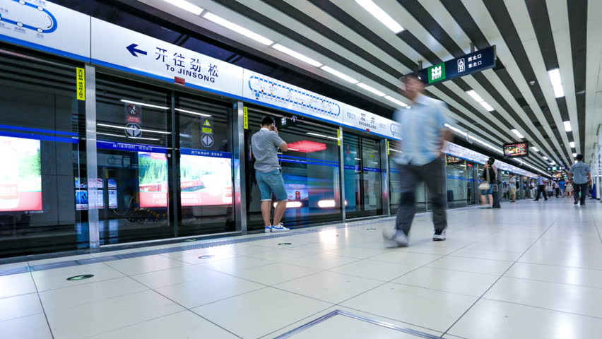 beijing - CIRCA JUNE 2013: People walking into subway station to go to work circa June 2013, China.Beijing subway has daily highest ferry passengers has break through 10 million person-time . - HD stock footage clip
