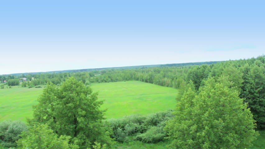 Flying over tree tops, neighborhood forest aerial view pilot pov