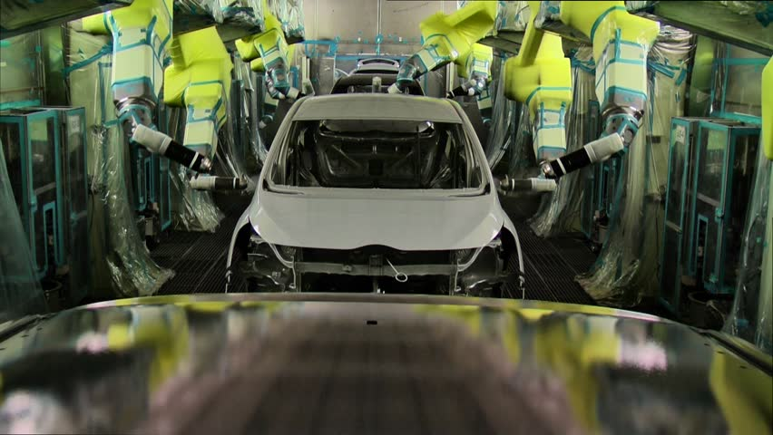 Robots are painting in automobile factory