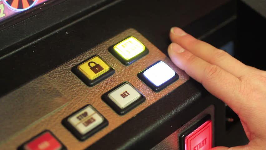 Playing poker-machines (video-poker) | Shutterstock HD Video #4204384