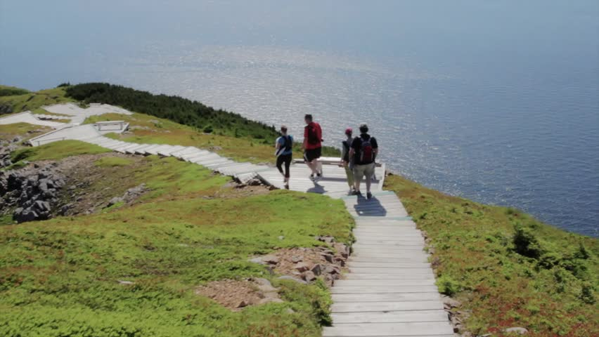Hikers on the beautiful skyline trail in cape breton nova scotia