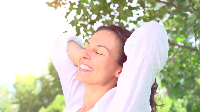 Beautiful Young Woman Outdoor. Enjoy Nature. Beauty Healthy Girl Relaxing in a Park. Healthy Skin and Hair. Countryside. Slow Motion video footage - HD stock video clip