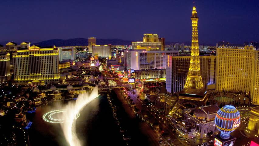 Illuminated view Paris hotel Eiffel Tower nr Bellagio fountains, Las Vegas Strip, USA