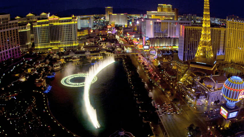 Illuminated view Bellagio fountains luxury hotels on Las Vegas Strip, USA - HD stock video clip