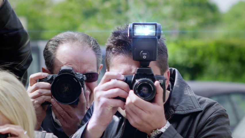 Celebrity Being Photographed By a Large Group of Paparazzi | Shutterstock HD Video #4208857