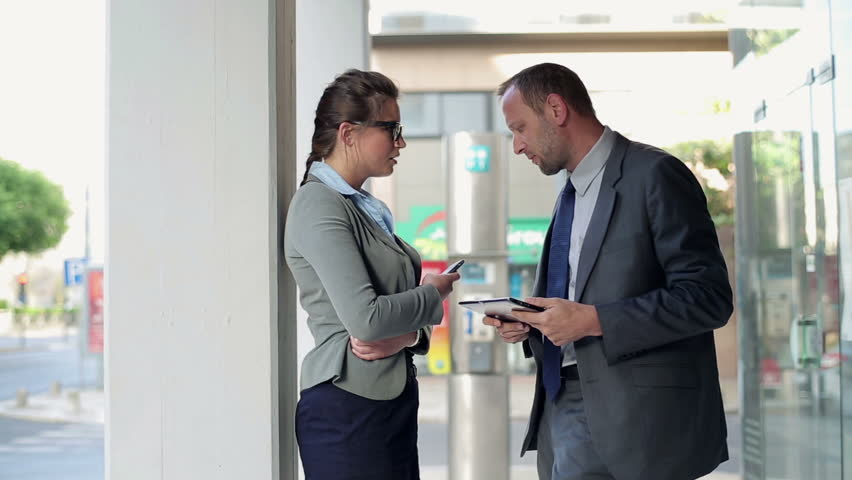 Business people with tablet and smartphone in the city