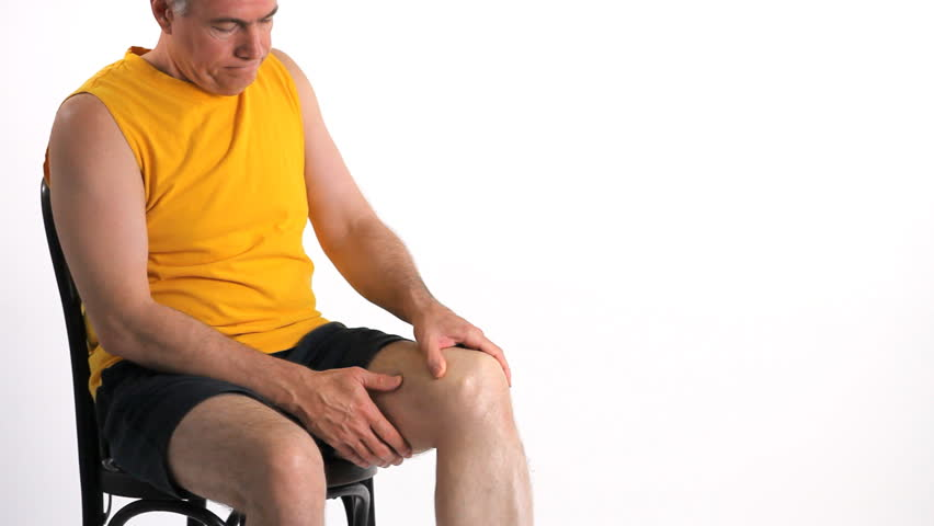 A man who is experiencing severe pain in his knee. - HD stock footage clip