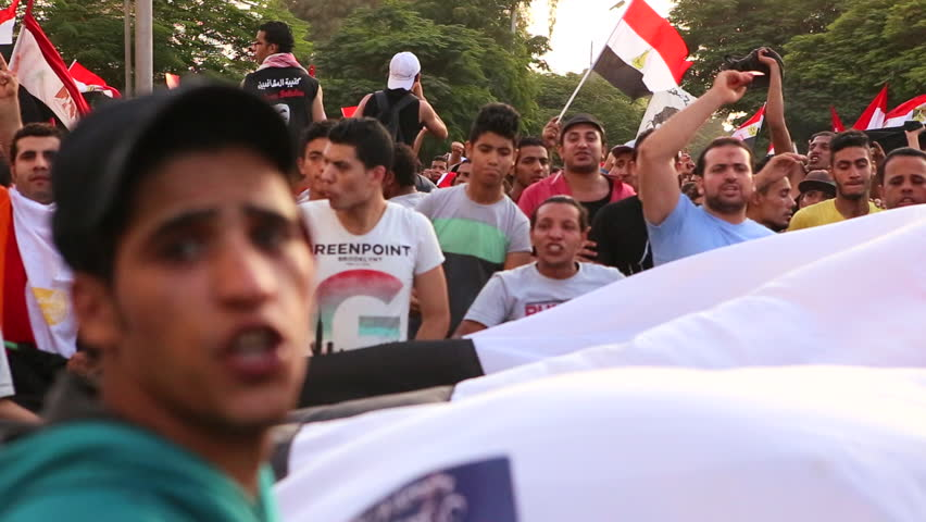 CAIRO, EGYPT - 2013: Protestors march in Cairo, Egypt following the coup that removed Morsi from office.