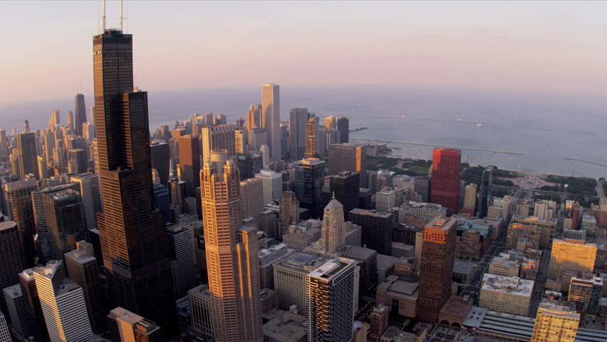 Aerial sunset view of Willis Tower from high elevation overlooking Downtown District Chicago, Illinois, USA, shot on RED EPIC