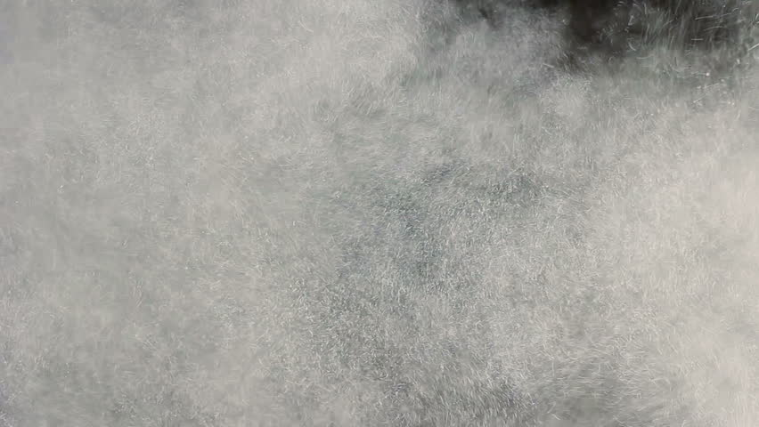 Close up of a dust explosion against black background