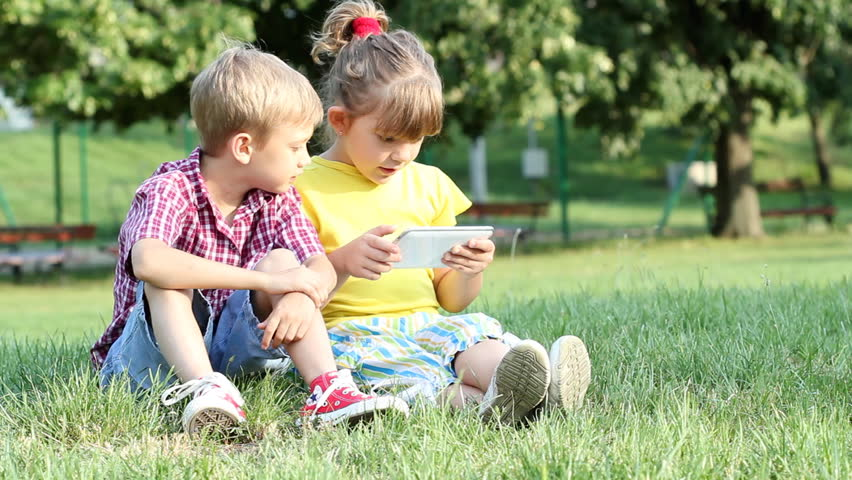little girl and boy play with tablet pc - HD stock footage clip