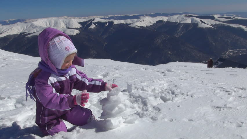 Child Playing In Snow In Mountains, Little Girl In Alpine ...