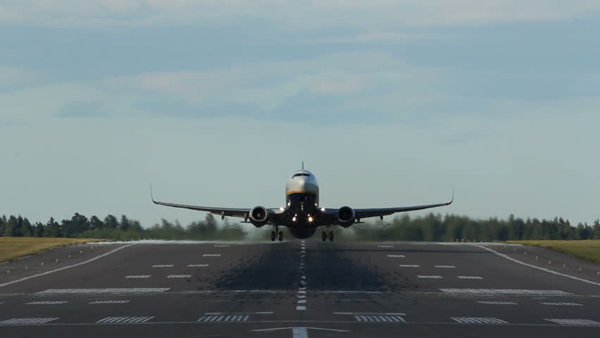 Jet plane staring on a runway, head on