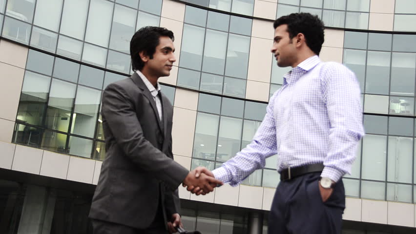 Shaky shot of two businessmen shaking hands