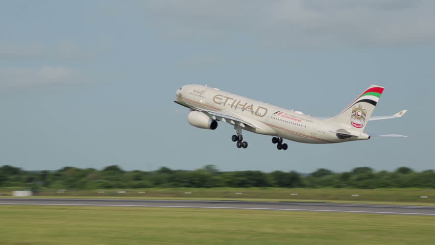 MANCHESTER, LANCASHIRE/ENGLAND - JULY 05: Etihad Airways Boeing 777 takes off from Manchester Airport on July 05, 2013 in Manchester. Etihad is the carrier for United Arab Emirates, founded in 2003.