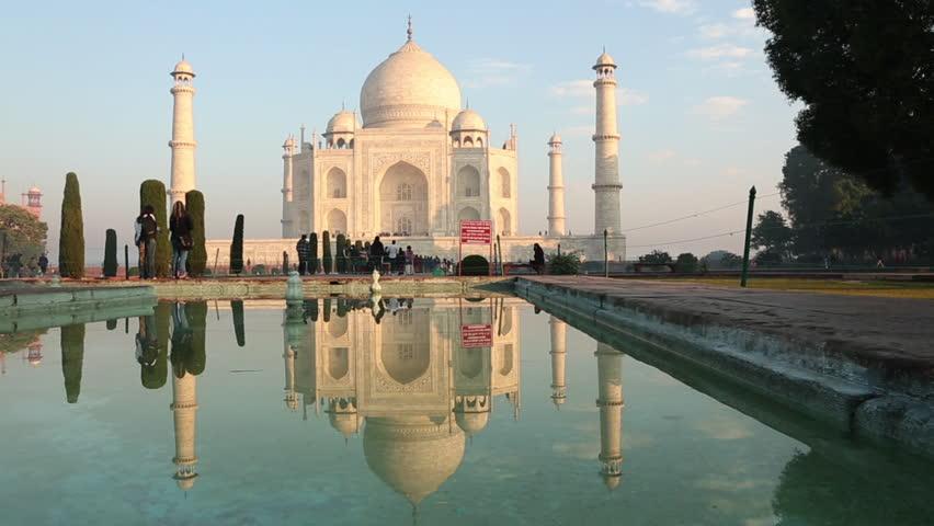 AGRA, INDIA - JAN 12 2012: Taj Majal reflected on water, Taj Mahal, Agra, Uttar Pradesh, India, 1/12/2012
