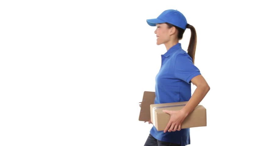 Female package delivery person. Courier giving packages in uniform. Woman courier smiling happy on white background. Beautiful young mixed race Caucasian / Chinese Asian female professional courier.