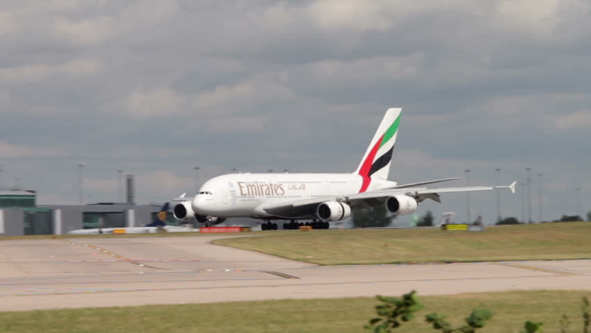 MANCHESTER, LANCASHIRE/ENGLAND - JULY 30: Emirates Boeing 777 taxis down the runway for take off on July 30, 2013 in Manchester. Emirates was voted Airline of the Year in 2013.