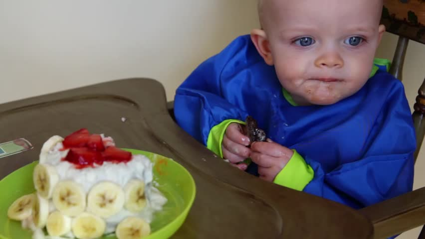 Baby Boy Eating His First Birthday Cake At His Party Stock Footage ...