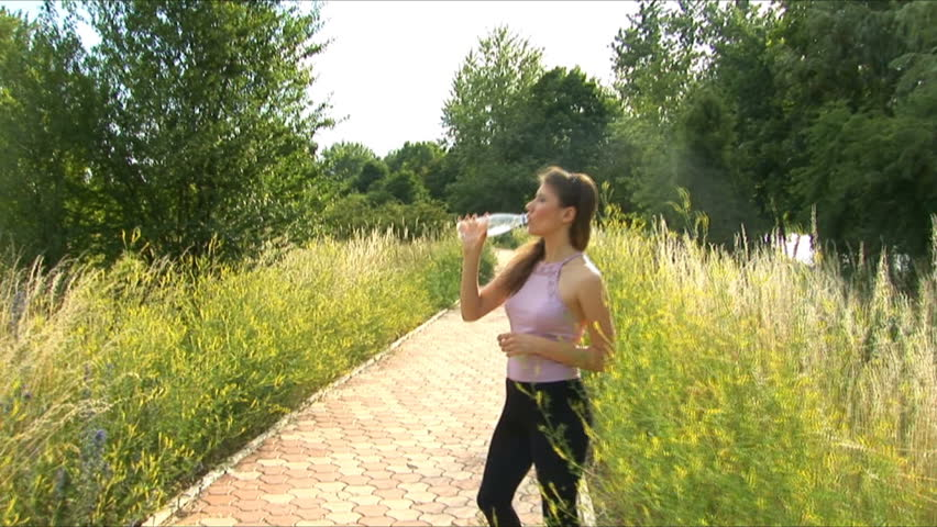 Girl drinks water after playing sports - HD stock video clip