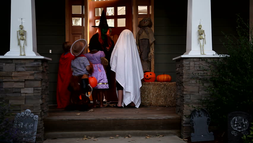 Children in Halloween costumes trick or treating