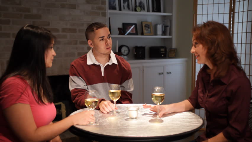 Three friends drinking wine and enjoying each other's company. - HD stock video clip